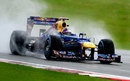 Sebastian Vettel looks for grip on the wet tyres