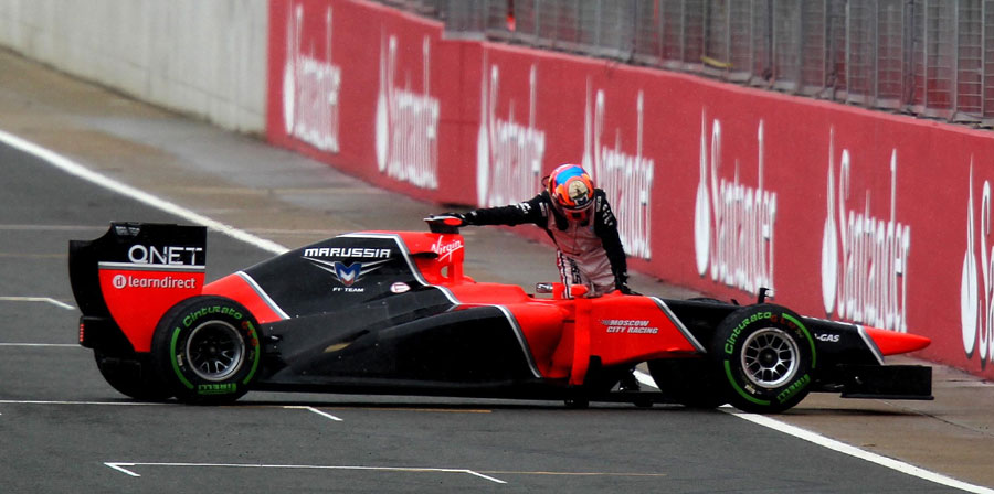 Timo Glock pushes his Marussia after a spin in qualifying