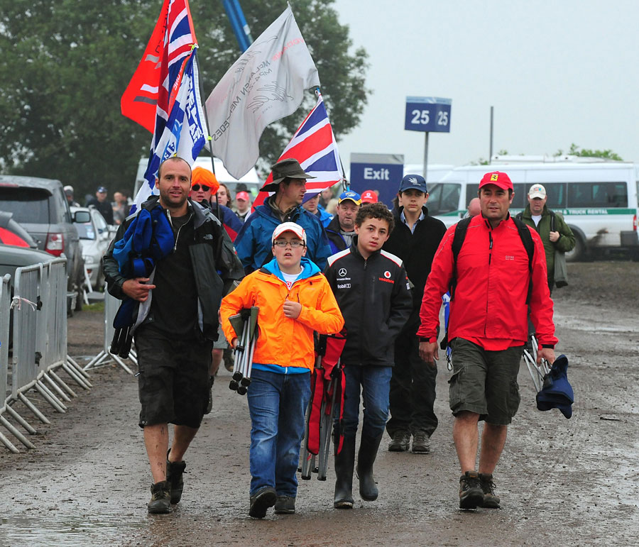 Fans arrive early at a wet Silverstone on race day