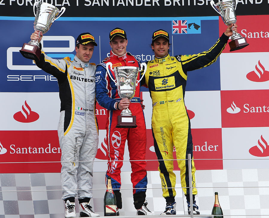 Luiz Razia celebrates victory in the GP2 sprint race ahead of Davide Valsecchi and Felipe Nasr
