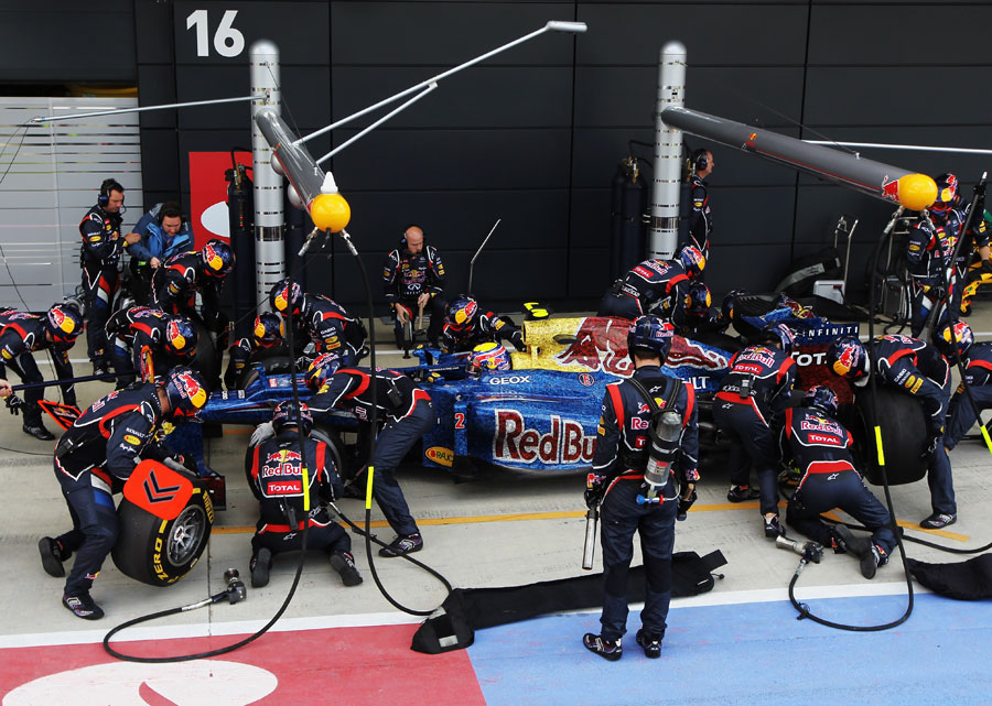Mark Webber makes a pit stop on his way to victory