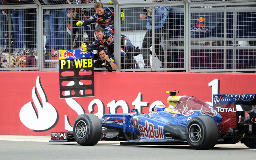 Mark Webber passes his pit board after taking victory