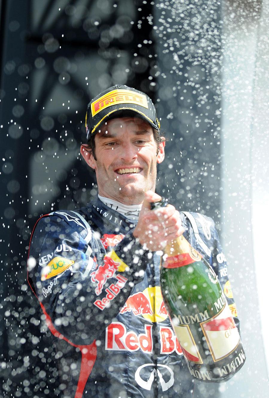 Mark Webber celebrates his victory on the podium