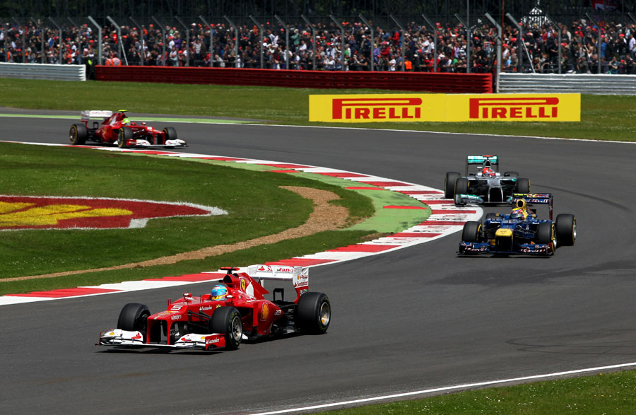 Fernando Alonso leads Mark Webber and Michael Schumacher early in the race