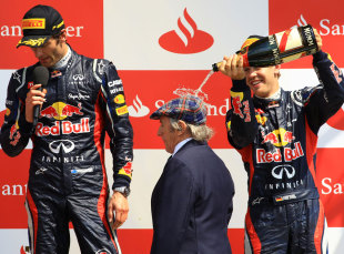Sebastian Vettel plays a joke on Sir Jackie Stewart as Mark Webber gives his victory speech