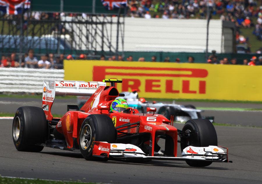 Felipe Massa leads Michael Schumacher in the race
