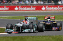 Michael Schumacher holds off Daniel Ricciardo