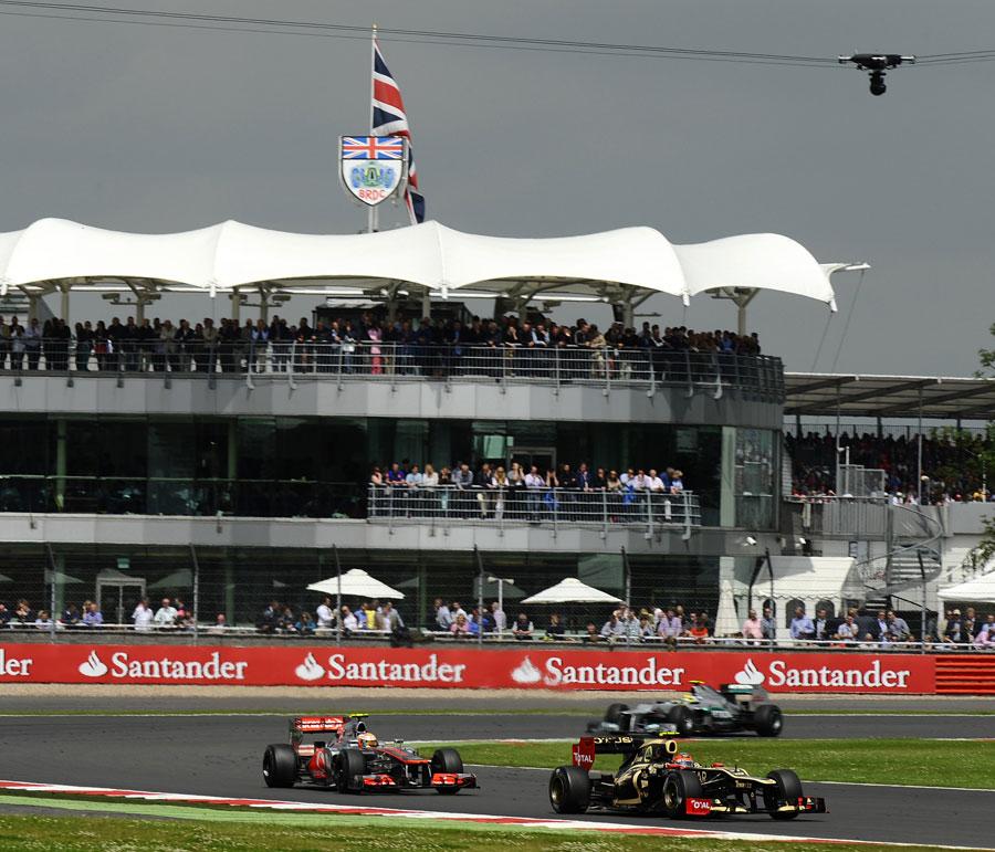 Romain Grosjean leads Lewis Hamilton
