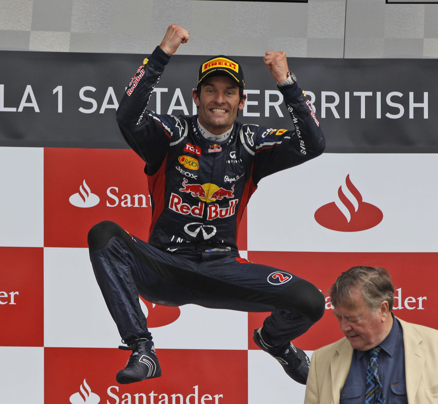 Mark Webber performs his customary celebration on the podium
