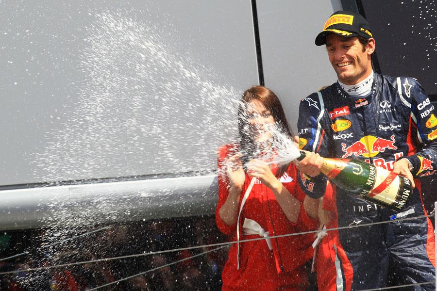 Mark Webber celebrates on the podium