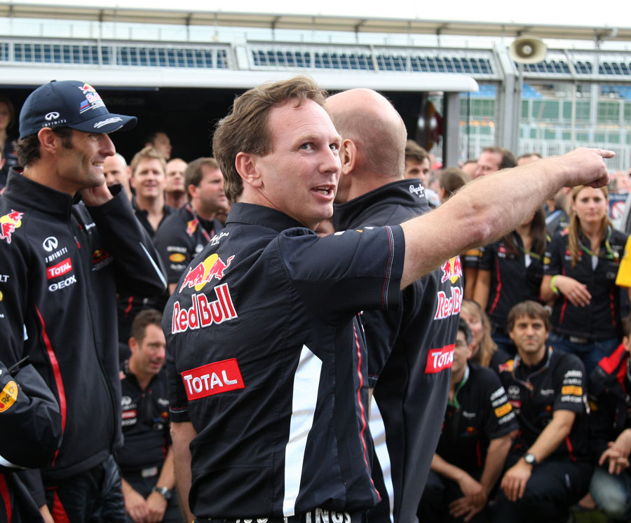 Christian Horner directs team members ahead of Mark Webber's celebration photo