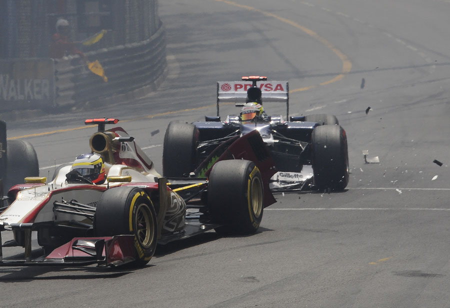 Pastor Maldonado crashes in to the back of Pedro de la Rosa at the start