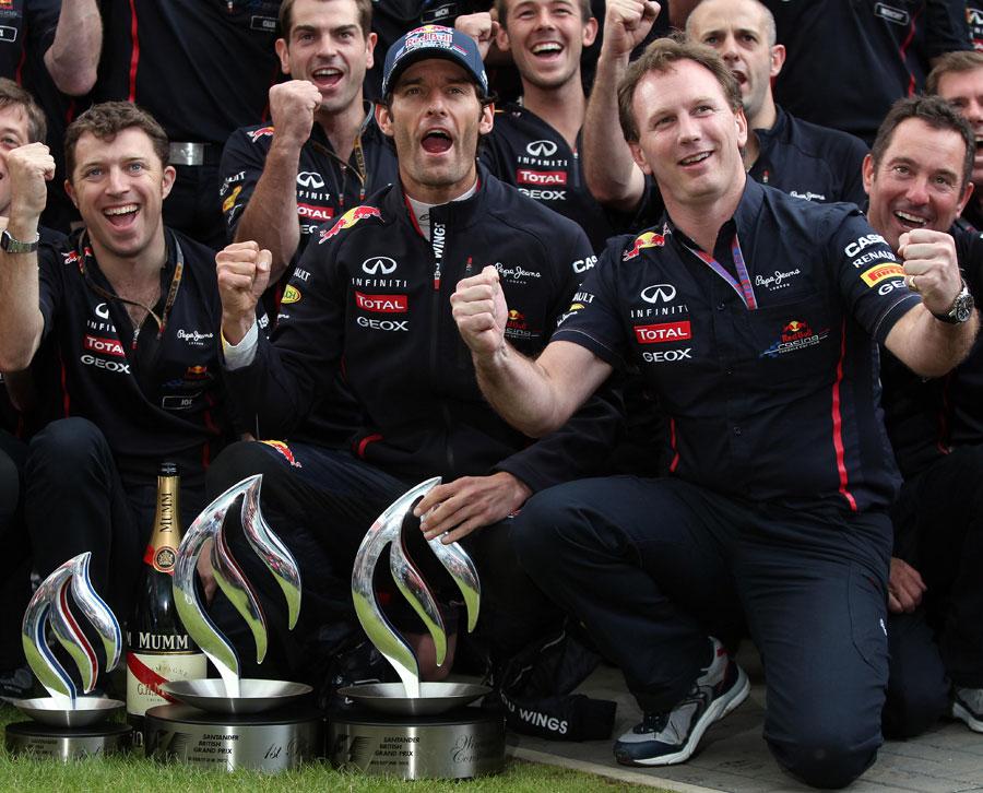 Mark Webber and Christian Horner celebrate Red Bull's 1-3 result