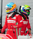 Fernando Alonso and Felipe Massa in parc ferme after Alonso secured pole position