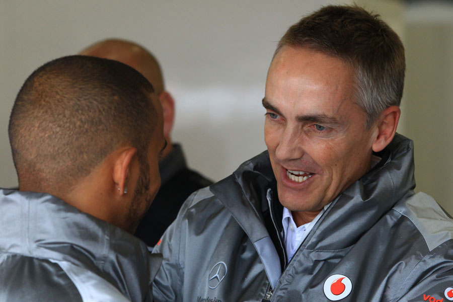 Martin Whitmarsh talks to Lewis Hamilton in the McLaren garage