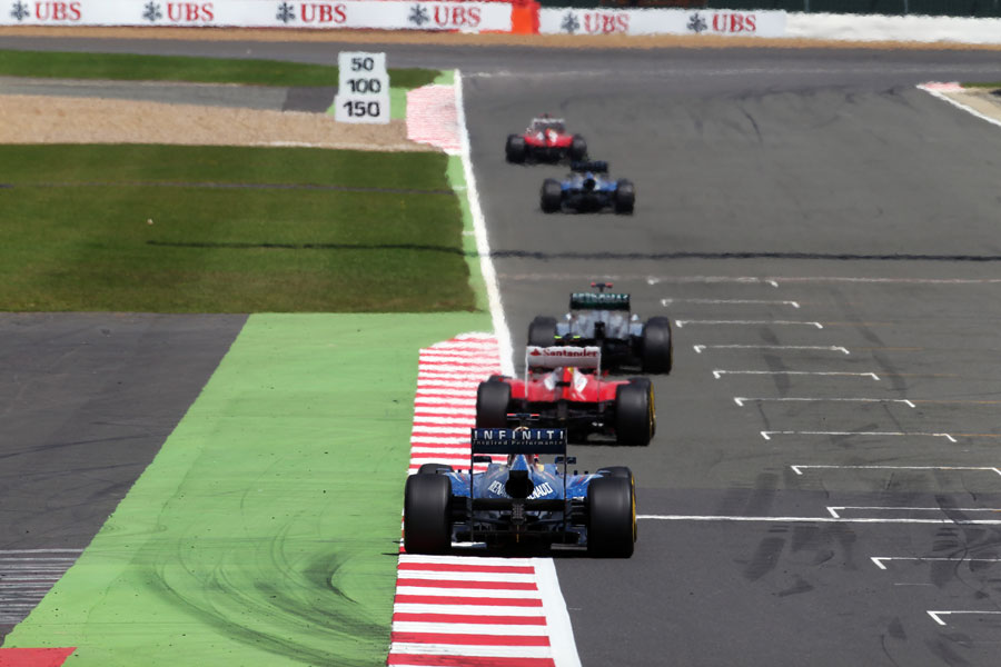 Fernando Alonso leads Mark Webber, Michael Schumacher, Felipe Massa and Sebastian Vettel early in the race