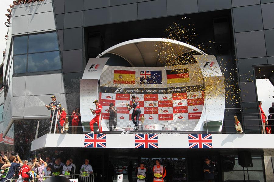 Mark Webber, Fernando Alonso and Sebastian Vettel celebrate on the podium