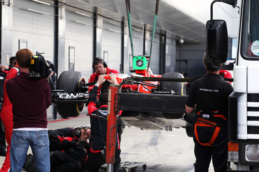 The Marussia is recovered to the pits