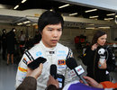 Ma Qing Hua talks to the press outside the HRT garage