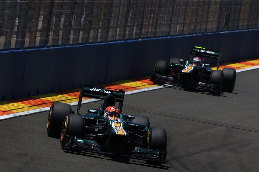 Heikki Kovalainen leads Vitaly Petrov