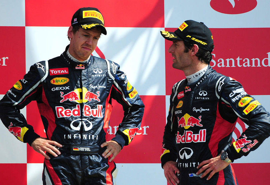 Sebastian Vettel and Mark Webber discuss their races on the podium
