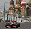 Lewis Hamilton drives a McLaren MP4-26 through Moscow on a demonstration run