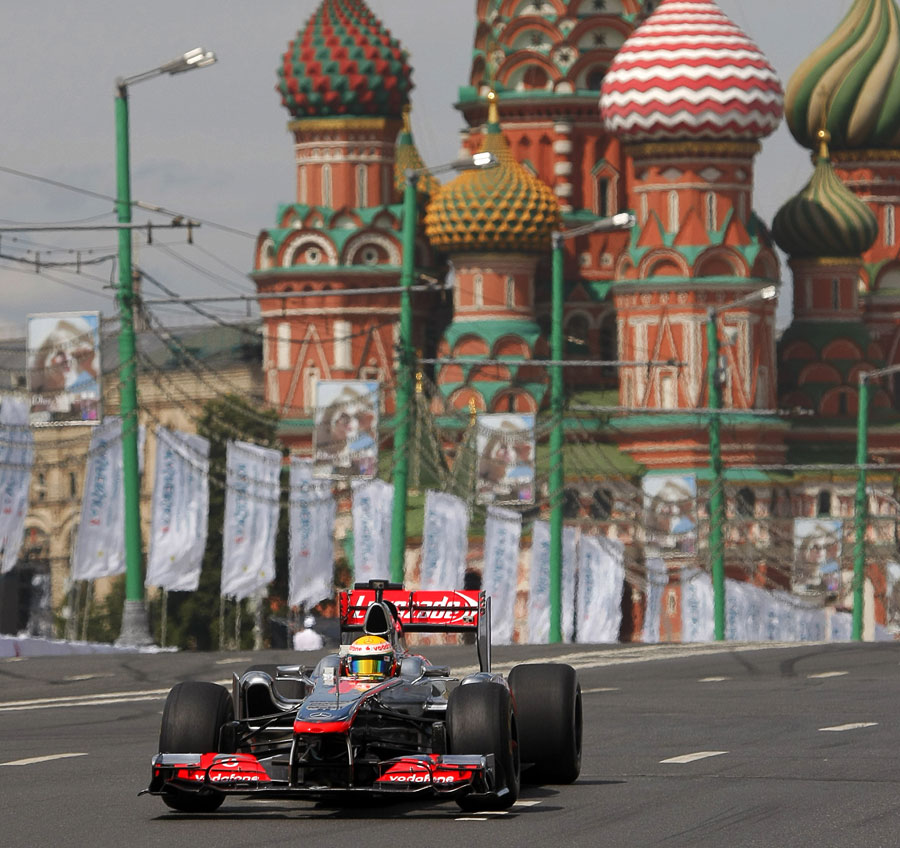Lewis Hamilton drives a McLaren MP4-26 through Moscow on a demonstration run
