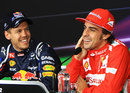 Sebastian Vettel and Fernando Alonso share a joke in the post-qualifying press conference