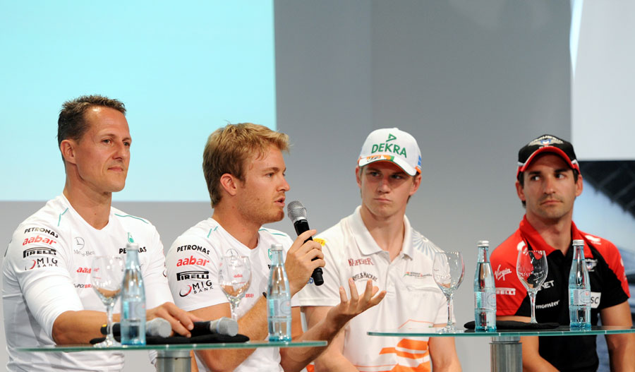 Nico Rosberg answers a question alongside his fellow German drivers during a FOTA Fans Forum