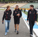Sebastian Vettel walks the track with his engineers