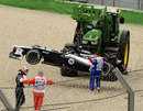 Valtteri Bottas is led away from the scene of his accident