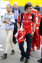 Fernando Alonso arrives in the paddock with his girlfriend Dasha Kapustina