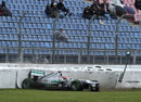 Michael Schumacher crashes in the wet at the end of FP2