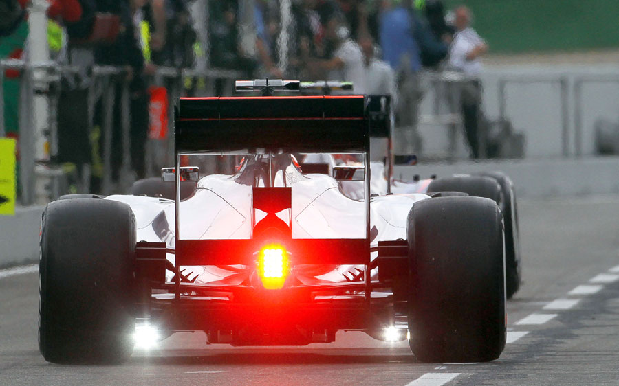 McLaren run measuring devices during the car's installation lap