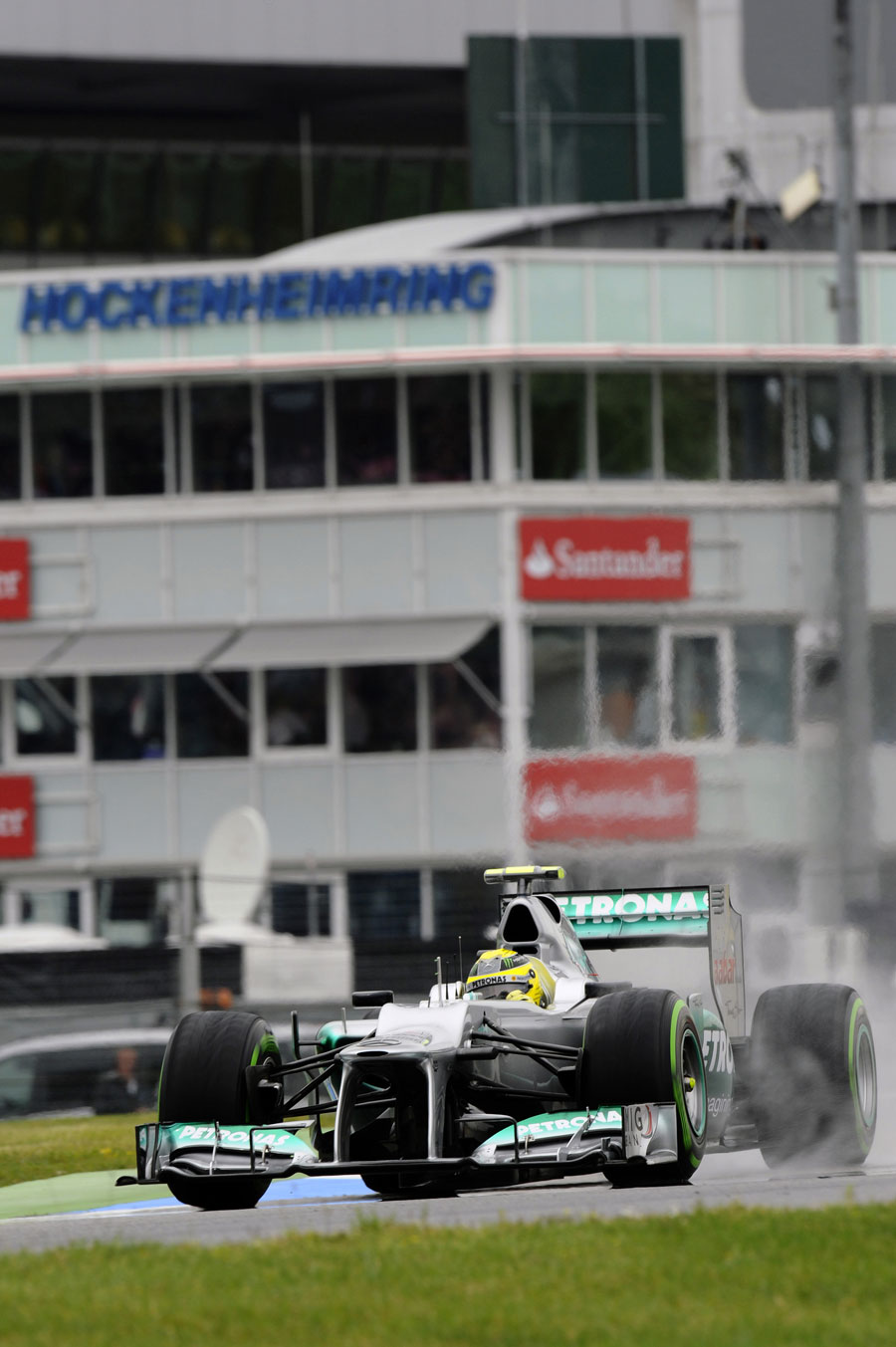 Nico Rosberg kicks up spray on the intermediate tyres