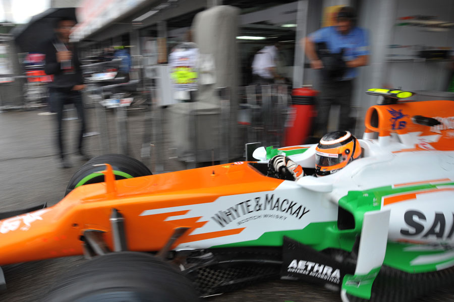 Nico Hulkenberg leaves the Force India garage