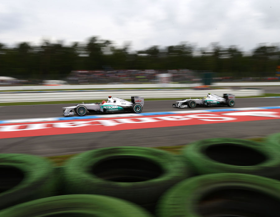 Michael Schumacher leads Nico Rosberg out of the hairpin