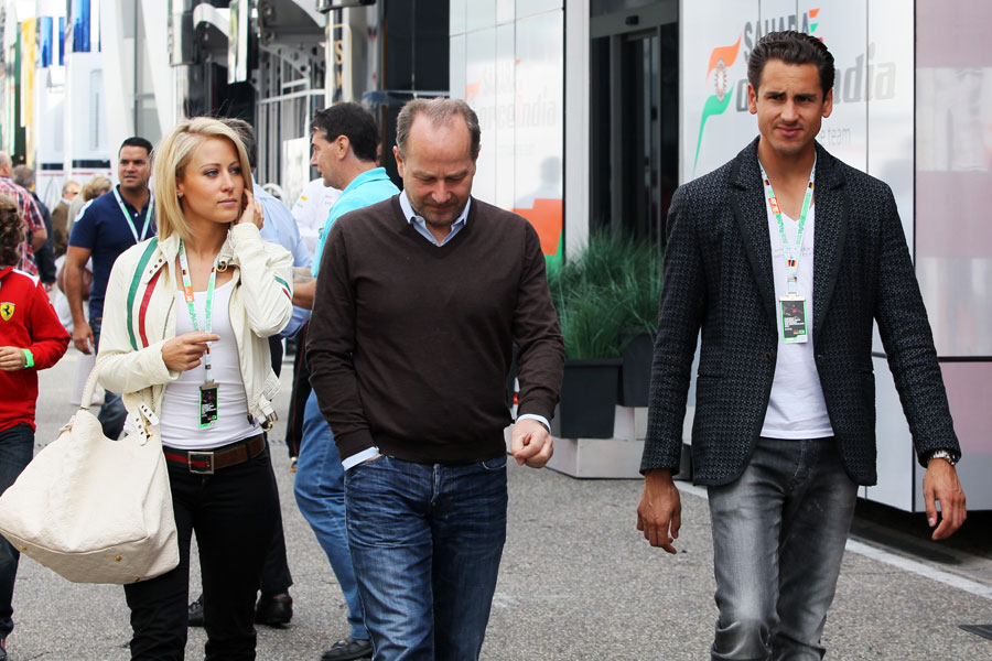 Adrian Sutil arrives at the circuit on Saturday with his manager Manfred Zimmerman