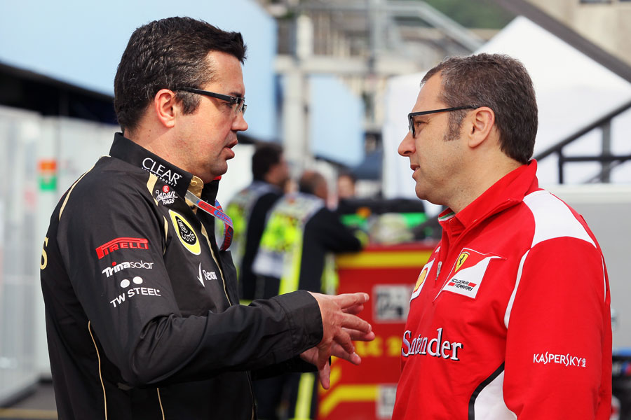 Eric Boullier and Stefano Domenicali deep in discussion in the paddock