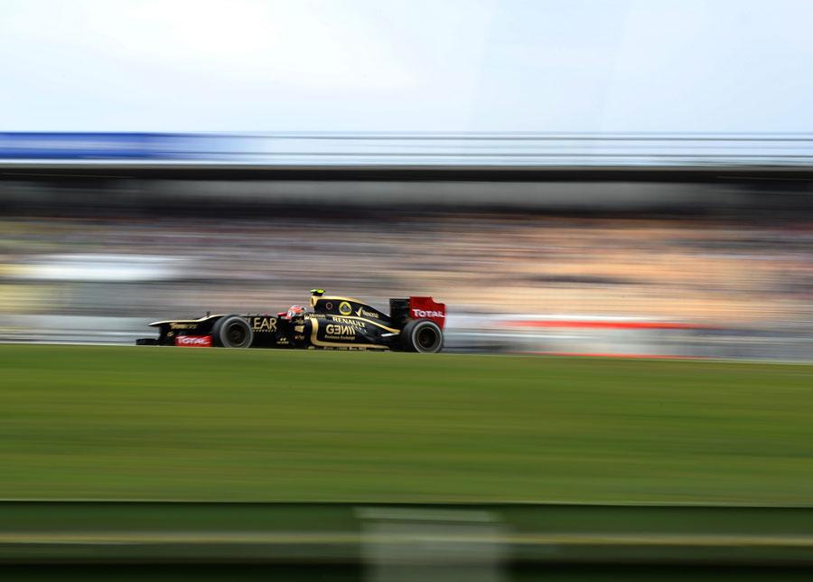 Romain Grosjean at speed in the stadium section
