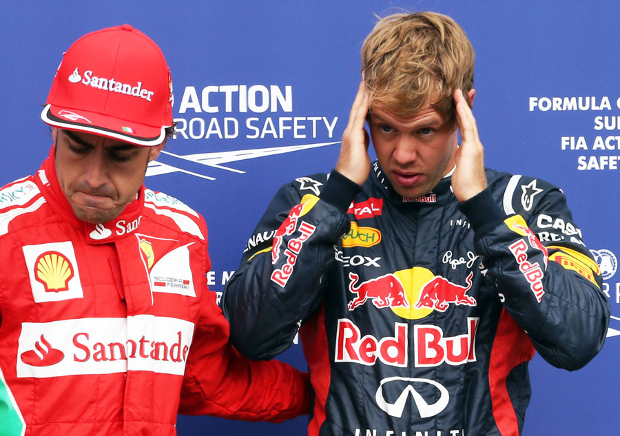 Fernando Alonso and Sebastian Vettel in parc ferme after qualifying