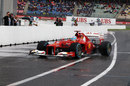 Fernando Alonso returns to parc ferme after taking pole