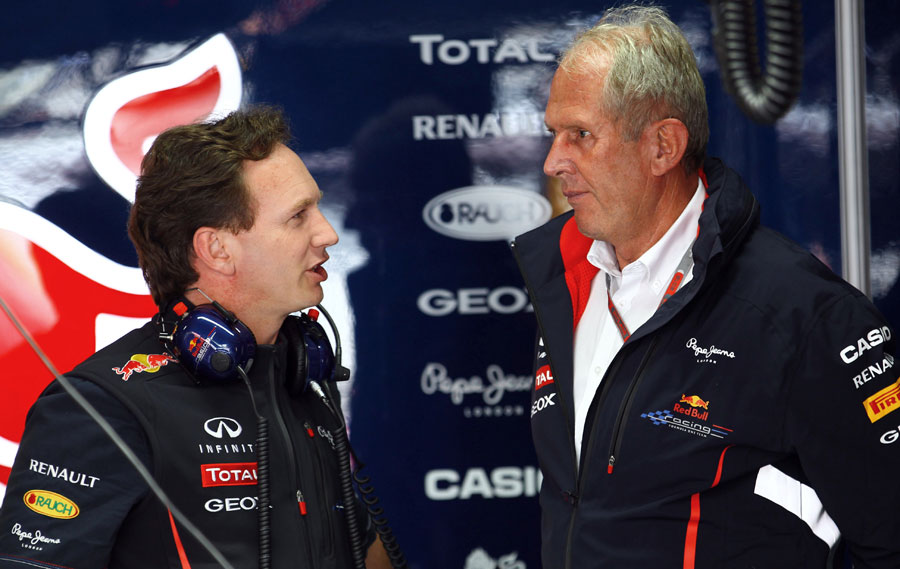 Christian Horner talks to Helmut Marko in the Red Bull garage