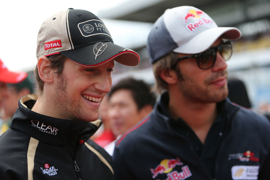 Romain Grosjean and Jean-Eric Vergne head to the drivers' parade
