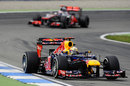 Sebastian Vettel leads Jenson Button
