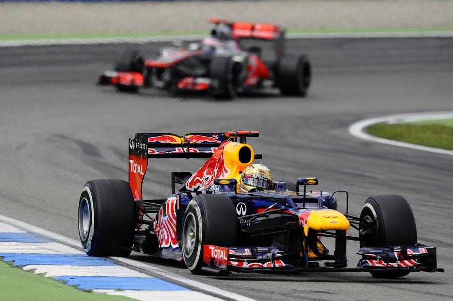 Sebastian Vettel leads Jenson Button