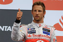 Jenson Button on the podium after the race