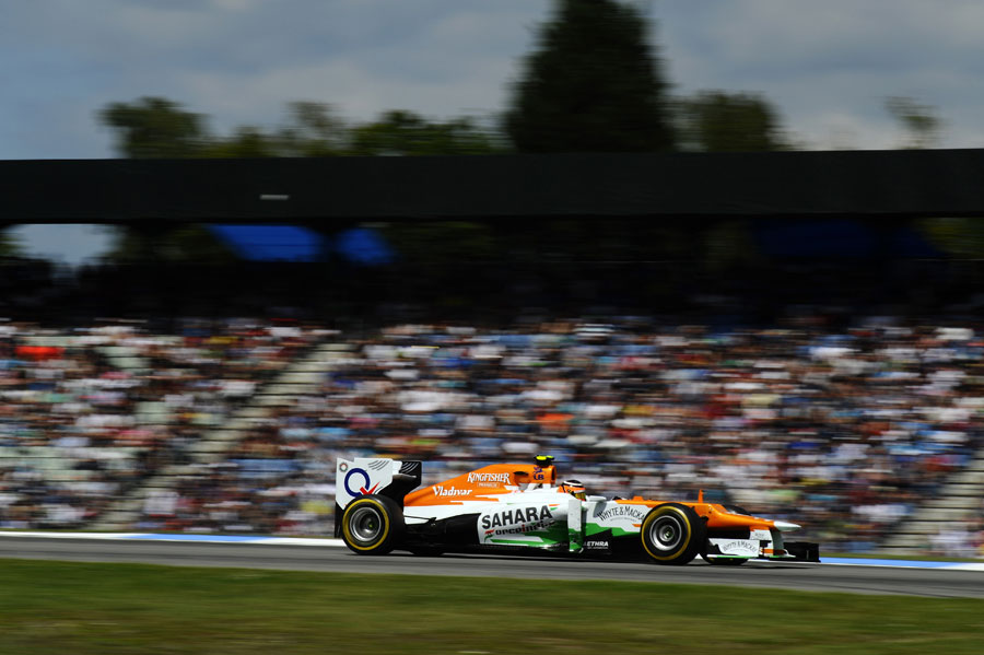 Nico Hulkenberg flashes past the grandstands on a soft tyre stint