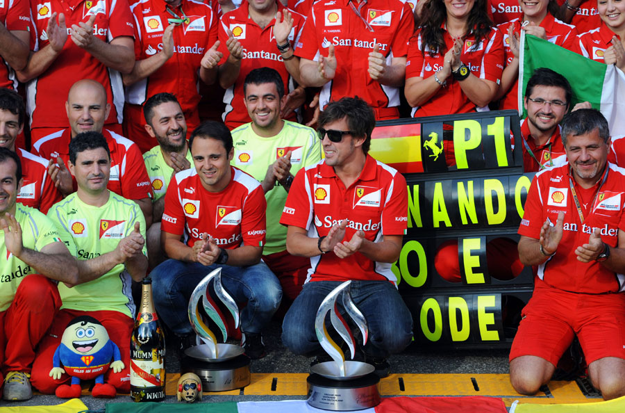 Fernando Alonso and Felipe Massa celebrate after the race