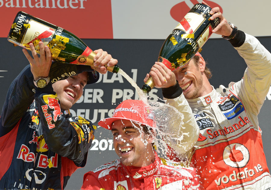 Sebastian Vettel and Jenson Button celebrate with Fernando Alonso